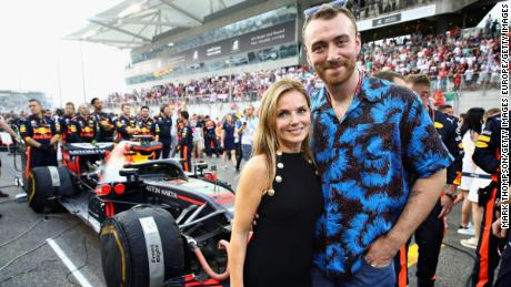 Geri poses with singer Sam Smith at the Abu Dhabi Grand Prix Formula 1 in 2018.
