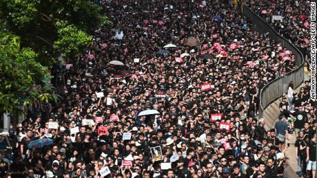 Thousands of protesters dressed in black take part in a new rally against a controversial extradition law proposal in Hong Kong on June 16, 2019. - Tens of thousands of people rallied in central Hong Kong on June 16 as public anger seethed following unprecedented clashes between protesters and police over an extradition law, despite a climbdown by the city's embattled leader. (Photo by Anthony WALLACE / AFP)        (Photo credit should read ANTHONY WALLACE/AFP/Getty Images)