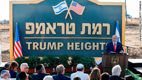 """Netanyahu gives a speech before a sign for the new settlement of """"Ramat Trump"""", or """"Trump Heights"""" in English, during a ceremony in the Golan Heights on June 16, 2019."""