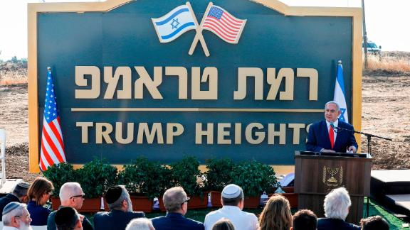 """Israeli Prime Minister Benjamin Netanyahu gives a speech before the newly-unveiled sign for the new settlement of """"Ramat Trump"""", or """"Trump Heights"""" in English, named after the incumbent US President during an official ceremony in the Israeli-annexed Golan Heights on June 16, 2019. - Netanyahu unveiled a """"Trump Heights"""" sign to mark the site of the new settlement, which comes after the US president in late March recognised Israeli sovereignty over the part of the strategic plateau it seized from Syria in the 1967 Six-Day war. (Photo by Jalaa MAREY / AFP)        (Photo credit should read JALAA MAREY/AFP/Getty Images)"""