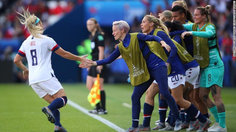 Julie Ertz celebrates with her teammates after scoring her team's second goal.