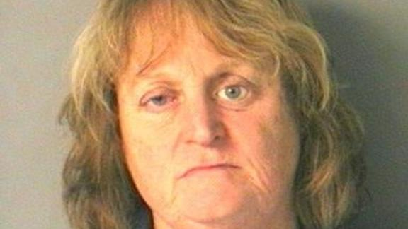 Image for Woman arrested after she pushed her dog in a lake and watched it drown