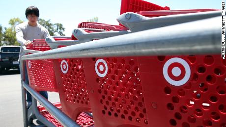 NOVATO, CA - MAY 22:  A customer grabs a shopping cart in the parking lot of a Target store on May 22, 2013 in Novato, California.  Target reported weaker than expected first quarter earnings with profits of $498 million, or 77 cents per share compared to $697 million, or $1.04 per share one year ago.  (Photo by Justin Sullivan/Getty Images)
