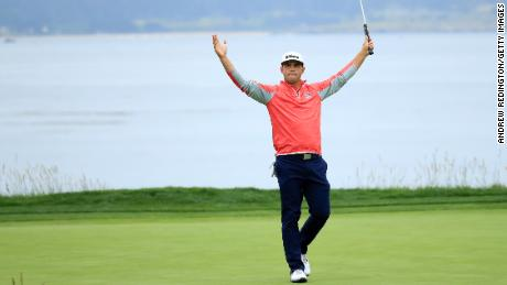Gary Woodland celebrates on the 18th green after winning the 2019 U.S. Open at Pebble Beach Golf Links on June 16, 2019.