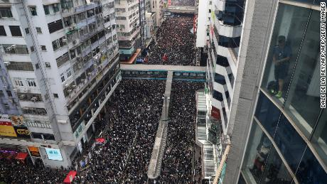 Hundreds of thousands of protesters dressed in black take part in a new rally against a controversial extradition law proposal in Hong Kong on June 16, 2019.