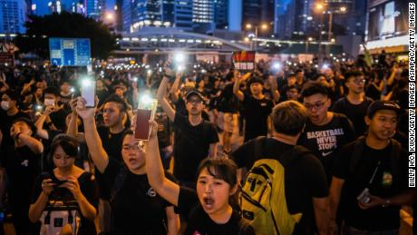 HONG KONG, HONG KONG - JUNE 16:  Protesters shine lights from their mobile phones during rally against a controversial extradition law proposal on June 16, 2019 in Hong Kong, China. Large numbers of protesters rallied on Sunday despite an announcement yesterday by Hong Kong's Chief Executive Carrie Lam that the controversial extradition bill will be suspended indefinitely. (Photo by Billy H.C. Kwok/Getty Images)