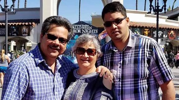 Shooting victim Kenneth French (right) and his parents, Russell and Paola French.