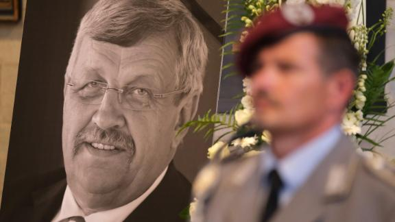 KASSEL, GERMANY - JUNE 13: An honor guard stands at a portrait and the coffin of murdered German politician Walter Lübcke at his memorial service at St. Martin church on June 13, 2019 in Kassel, Germany. Lübcke was found dead, shot in the head at close range, on the terrace of his home on June 2. Investigators have ruled out suicide and are investigating the case as murder. Lübcke, a Christian Democrat (CDU), was outspoken in his pro-immigration views, and one possibility investigators are pursuing is a right-wing motive to the shooting. (Photo by Sean Gallup/Getty Images)