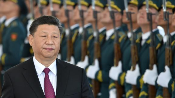 Chinese President Xi Jinping walks past honor guards during a welcoming ceremony prior to the talks with his Kyrgyz counterpart in Bishkek on June 13, 2019.