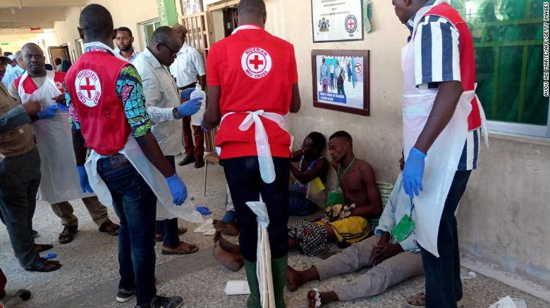 IMG Red Cross officials attend to some victims injured in the Konduga bombings on Monday.