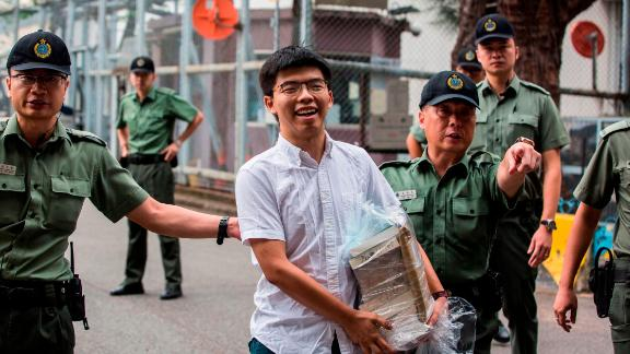 Hong Kong democracy activist Joshua Wong (C) leaves Lai Chi Kok Correctional Institute in Hong Kong on June 17, 2019. - Wong called on the city's pro-Beijing leader Carrie Lam to resign after he walked free from prison, as historic anti-government protests rocked the city. (Photo by ISAAC LAWRENCE / AFP)        (Photo credit should read ISAAC LAWRENCE/AFP/Getty Images)