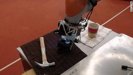 MIT researchers used a sophisticated touch sensor and a web camera to teach robots to predict what something feels like by looking at it.
