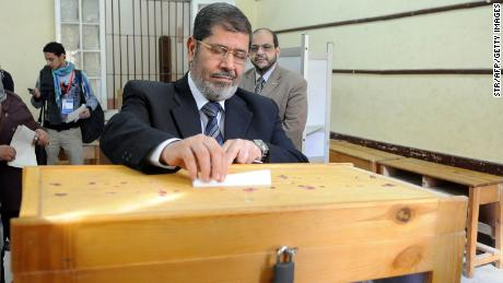 Mohammed Mursi, head of the Islamist Freedom and Justice Party, casts his ballot at a polling station in Zagazig city, 80 kms northeast of Cairo, on December 15, 2011 during the second round of parliamentary elections. (Photo/STR/AFP/GettyImages)