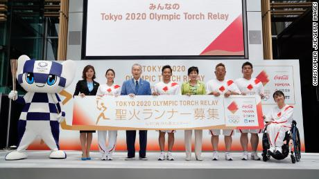 TOKYO, JAPAN - JUNE 01: (L-R) Tokyo 2020 mascot Miratowa, Miho Takeda,  Satomi Ishihara, Yoshiro Mori, Tadahiro Nomura, Yuriko Koike, Mikio Date, Takeshi Tomizawa and Aki Taguchi pose for the media during the Tokyo 2020 Torch Relay 300 Days To Go event at the Tokyo Midtown on June 01, 2019 in Tokyo, Japan. (Photo by Christopher Jue/Getty Images)
