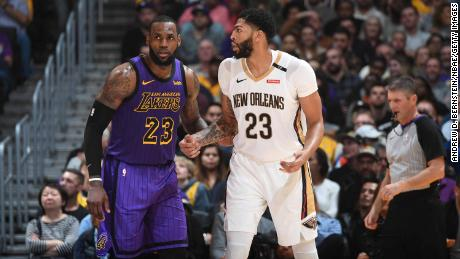 LOS ANGELES, CA - DECEMBER 21: LeBron James #23 of the Los Angeles Lakers and Anthony Davis #23 of the New Orleans Pelicans fight for position during a game on December 21, 2018 at STAPLES Center in Los Angeles, California. NOTE TO USER: User expressly acknowledges and agrees that, by downloading and/or using this Photograph, user is consenting to the terms and conditions of the Getty Images License Agreement. Mandatory Copyright Notice: Copyright 2018 NBAE (Photo by Andrew D. Bernstein/NBAE via Getty Images)