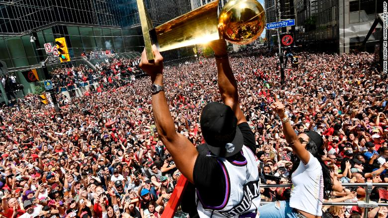 The Toronto Raptors celebrate their first NBA championship with fans Monday.