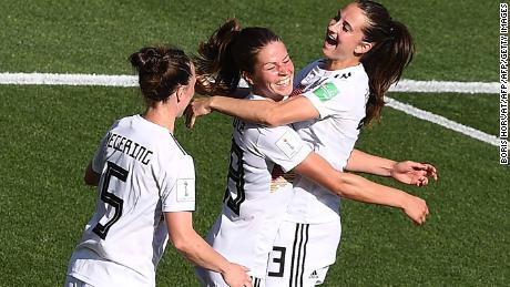 Melanie Leupolz (center) celebrates her goal in Marseille