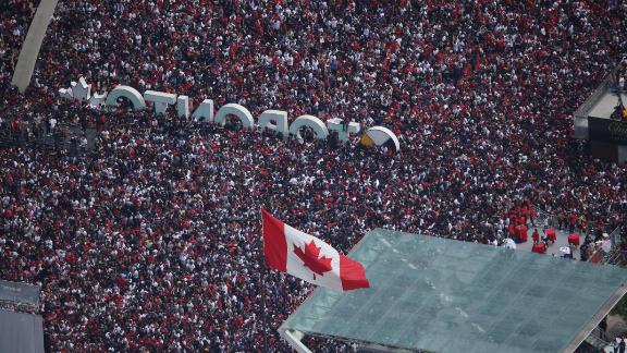 Fans gather at Nathan Phillips Square for the Toronto Raptors' NBA Championship Victory Parade.
