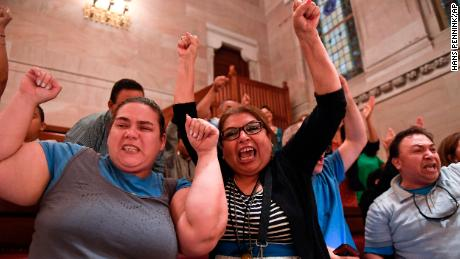 Spectators celebrate after legislation sponsoring the Green Light Bill granting undocumented Immigrant driver's licenses was passed by the Senate during a Senate session at the state Capitol Monday, June 17, 2019, in Albany, N.Y. (AP Photo/Hans Pennink)