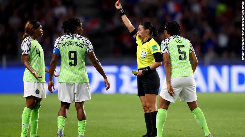 Referee Melissa Borjas shows Ebere a red card.