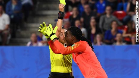 Nigeria's goalkeeper Nnadozie reacts as Honduran referee  Melissa Borjas decides France can re-take a penalty.