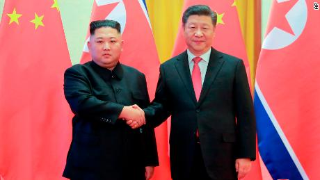 North Korean leader Kim Jong Un, left, and Chinese President Xi Jinping pose for photographs during a previous meeting at the Great Hall of the People in Beijing, January 8, 2019.