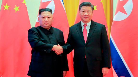 In this Jan. 8 photo provided by the North Korean government, North Korean leader Kim Jong Un, left, and Chinese President Xi Jinping pose for photographs at the Great Hall of the People in Beijing.
