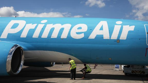 A Prime Air cargo plane, operated by Amazon.com Inc., sits on on display ahead of the 53rd International Paris Air Show at Le Bourget in Paris, France, on Sunday, June 16, 2019. The show is the world's largest aviation and space industry exhibition and runs from June 17-23. Photographer: Jason Alden/Bloomberg via Getty Images