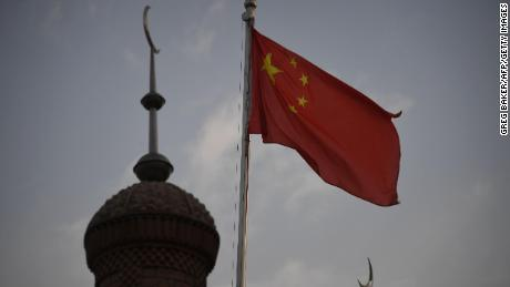 This photo taken on June 4, 2019 shows the Chinese flag flying over the Juma mosque in the restored old city area of Kashgar, in China's western Xinjiang region. - While Muslims around the world celebrated the end of Ramadan with early morning prayers and festivities this week, the recent destruction of dozens of mosques in Xinjiang highlights the increasing pressure Uighurs and other ethnic minorities face in the heavily-policed region. (Photo by GREG BAKER / AFP) / To go with AFP story China-politics-rights-religion-Xinjiang, FOCUS by Eva Xiao and Pak Yiu        (Photo credit should read GREG BAKER/AFP/Getty Images)