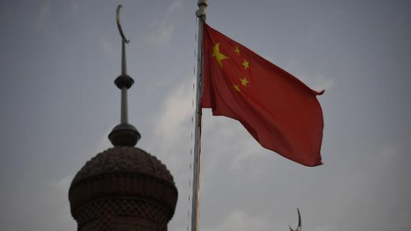 This photo taken on June 4, 2019 shows the Chinese flag flying over the Juma mosque in the restored old city area of Kashgar, in China