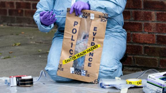Forensics teams work at the scene of a stabbing in Edmonton, London, on March 31, 2019.