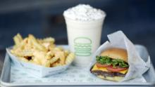 A ShackBurger, cheese fries, and milkshake are arranged for a photograph at a Shake Shack Inc. restaurant in Lexington, Kentucky, U.S., on Wednesday, March 6, 2019. Shake Shack is still failing to bring in more diners as it expands outside its home market of New York in the fiercely competitive restaurant space -- the chain plans to open 36 to 40 company-owned U.S. locations in fiscal 2019. Photographer: Luke Sharrett/Bloomberg via Getty Images