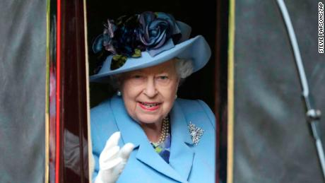 Britain's Queen Elizabeth looks out from a carriage in Windsor Great Park on her way to Royal Ascot horse race meeting in Ascot, England, Tuesday, June 18, 2019. (Steve Parsons/PA via AP)