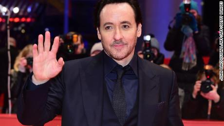 "US actor John Cusack poses upon arrival for the film ""Chi-Raq"" screened out of competition at the 66th Berlinale Film Festival in Berlin on February 16, 2016. / AFP / John MACDOUGALL        (Photo credit should read JOHN MACDOUGALL/AFP/Getty Images)"