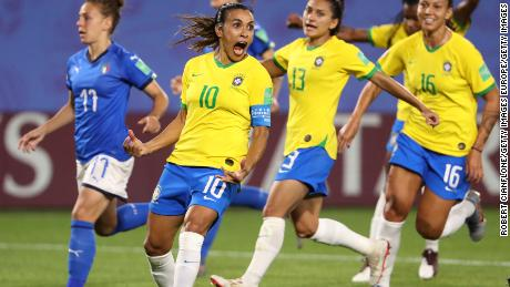 VALENCIENNES, FRANCE - JUNE 18: Marta of Brazil celebrates with teammates after scoring her team's first goal during the 2019 FIFA Women's World Cup France group C match between Italy and Brazil at Stade du Hainaut on June 18, 2019 in Valenciennes, France. (Photo by Robert Cianflone/Getty Images)