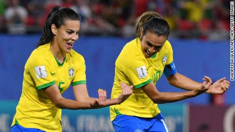 Marta celebrates with Brazil's midfielder Thaisa after scoring against Italy.