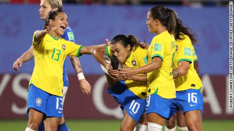 Marta celebrates with teammates after her record-breaking goal.