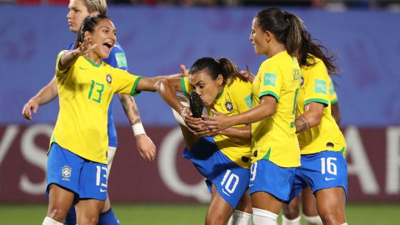Marta kisses her boot after becoming the first player to score in five Women's World Cup tournaments.