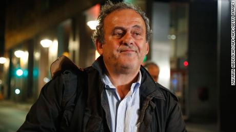 "Ex-UEFA chief Michel Platini, flanked by his lawyer William Bourdon, talks to the media as he leaves the Central Office for Combating Corruption and Financial and Tax Crimes after being arrested in connection with a criminal investigation into the award of the 2022 World Cup to Qatar, in Nanterre, west of Paris in the early hours of June 19, 2019. - The banned ex-UEFA chief Michel Platini was freed from French custody Wednesday, an AFP journalist said, after several hours of questioning in connection with a criminal investigation into the awarding of the 2022 World Cup to Qatar. ""He is no longer in custody,"" William Bourdon, the lawyer of the French football legend, said shortly before 1:00 am. There had been ""a lot of fuss over nothing"", he added. (Photo by Zakaria ABDELKAFI / AFP)        (Photo credit should read ZAKARIA ABDELKAFI/AFP/Getty Images)"
