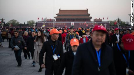In this picture taken on April 1, 2019, tourists visit Tiananmen square after the flag-raising ceremony in Beijing. - Thirty years after the crackdown on Tiananmen protesters, the tanks that lined Beijing's central avenue have been replaced by countless surveillance cameras perched like hawks on lampposts to keep the population in check. (Photo by STR / AFP) / To go with China-Politics-Tiananmen, Focus by Poornima Weerasekara        (Photo credit should read STR/AFP/Getty Images)