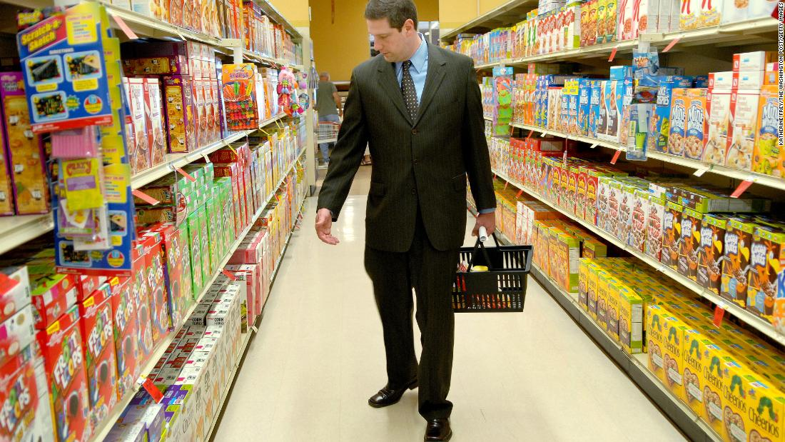 "Ryan shops at a supermarket in May 2007. He was among the congressmen taking a ""Food Stamp Challenge"" to see what it was like eating for a week with just $21 in groceries."