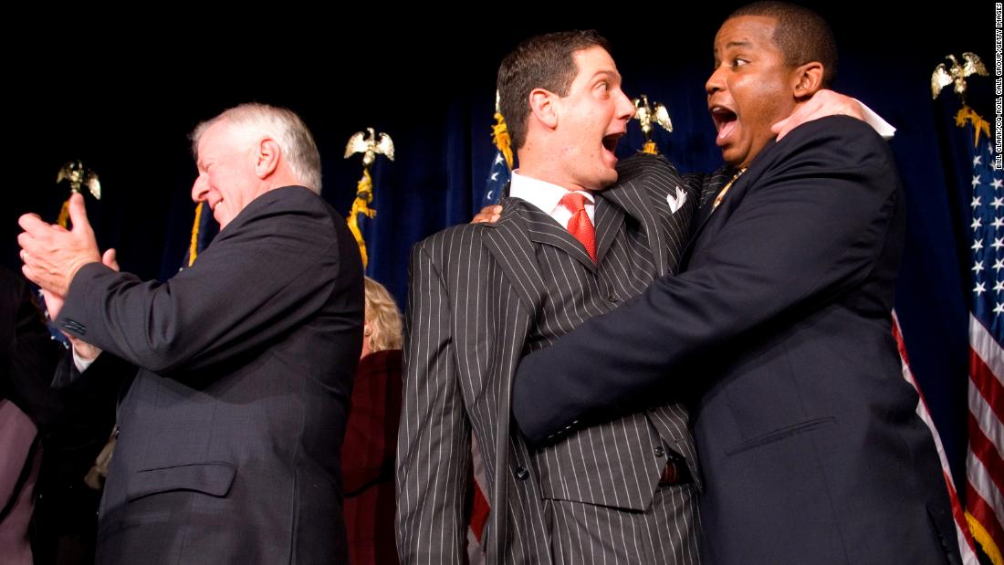 Ryan hugs US Rep. Kendrick Meek at an election-night party in Washington in November 2006. The Democratic Party secured the House majority for the first time since 1994.