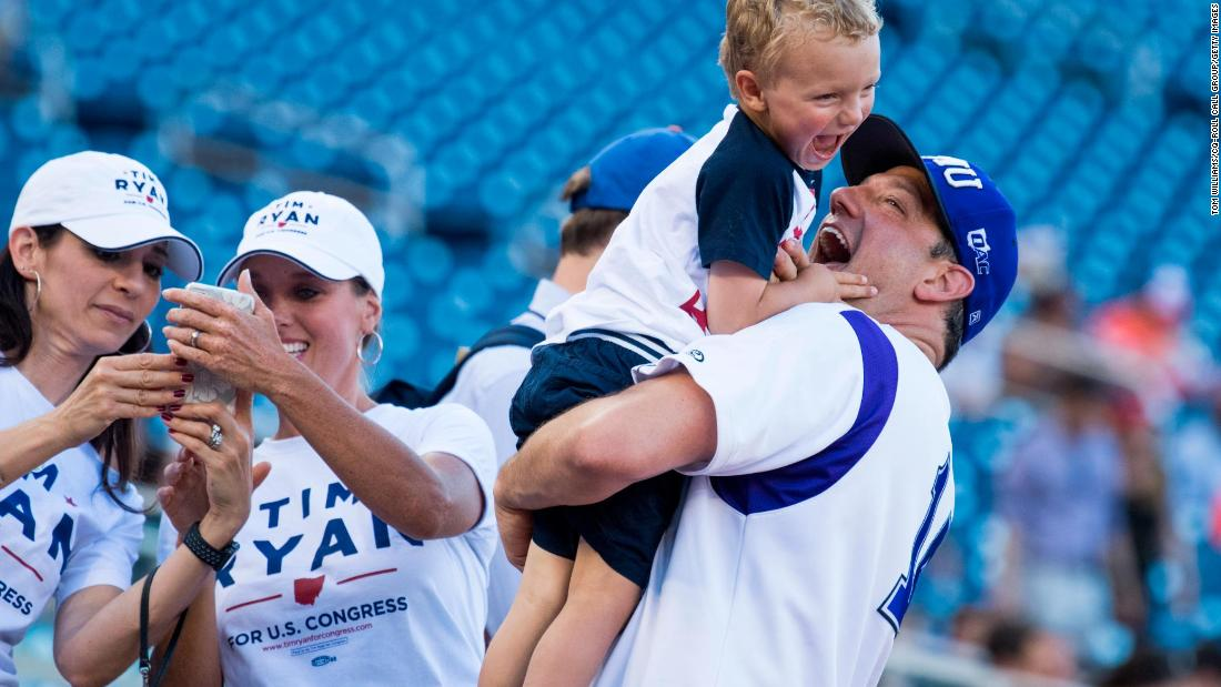 Ryan holds his son Brady before the Congressional Baseball Game in June 2018.