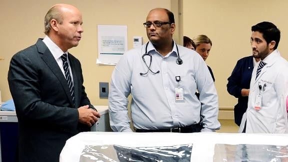Delaney talks with staff members at Hagerstown's Meritus Medical Center while reviewing the hospital's Ebola preparations in October 2014.