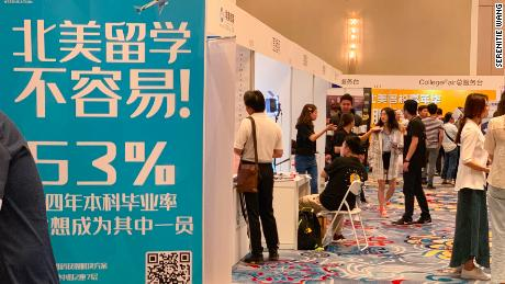 "A study abroad poster that reads ""it's not easy to study in North America"" is seen at a recent study abroad fair in Beijing. In recent months, Chinese students studying on the US have found themselves on the front lines of the raging US-China trade war, with many alleging tightened visa restrictions and diplomatic checks."