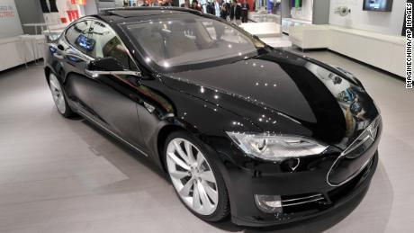 A black Model S electric car is displayed at the Tesla store in Beijing, China, 5 November 2013.  US electric carmaker Tesla Motors opened its first showroom in China over the weekend, taking pre-orders from customers at its Beijing location. Located on the East Third Ring Road, the showroom opened its doors to the public on Saturday (2 November 2013), displaying two Tesla Model S four-door sports cars, one black and one white. We have seen roaring interest since the pre-order started in late August, Ma Li, a product specialist, said. The intended buyers can sign a pre-order contract and put down a 250,000 yuan (US$40,000) deposit to add their names to the waiting list. Information released by the company is that its planned allotment of 100 cars for the China market will quickly sell out. Still awaiting government approval for the import and sale of Tesla electric cars, Ma told China Daily that potential customers in China may have to wait until next year for the first batch of Model S cars to arrive. The price tag for the various models may stand between 900,000 yuan ($146,000) and 1.2 million yuan ($195,500), Ma said, adding that if customers are not satisfied, they can get their deposit back.