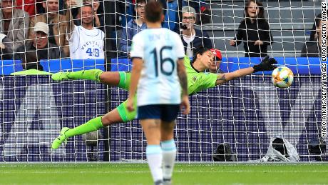 LE HAVRE, FRANCE - JUNE 14: Vanina Correa of Argentina saves a  penalty from Nikita Parris of England (not pictured)during the 2019 FIFA Women's World Cup France group D match between England and Argentina at  on June 14, 2019 in Le Havre, France. (Photo by Marc Atkins/Getty Images)