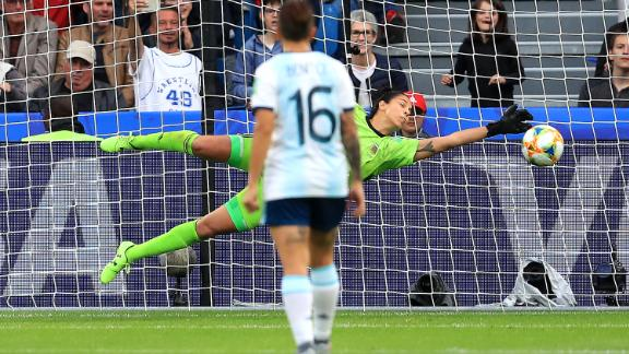 Correa of Argentina saves a  penalty from England's Nikita Parris.