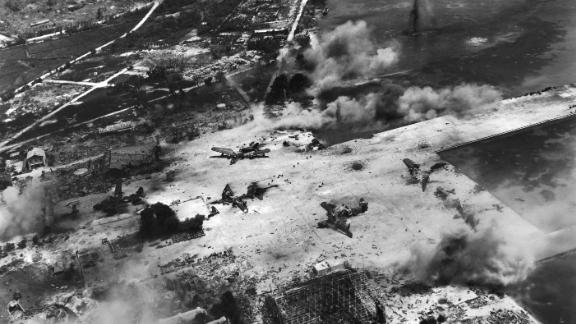 An aerial view of smoke from the US artillery and naval bombardment of a Japanese seaplane base at Flores Point, near Tanapag harbor, during the US invasion of Saipan in June 1944.