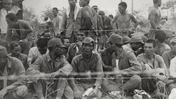 Japanese POWs seen in an enclosure during the Battle of Saipan are some of the more than 900 who surrendered on Saipan.